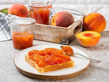 Peach Jam on Bread and Fresh Peaches