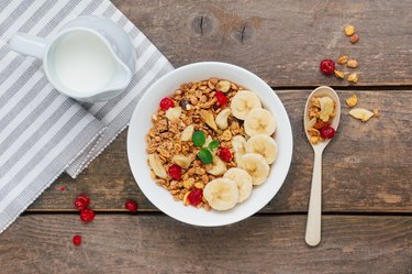 Granola with banana and berries in the bowl