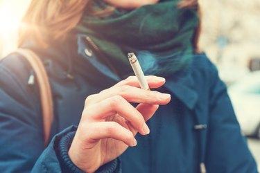 Young woman enjoying a cigarette