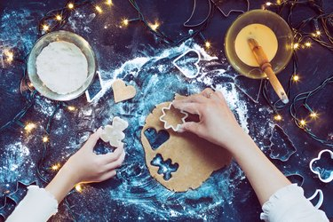 High Angle View Of Hands Making Healthy Cookies