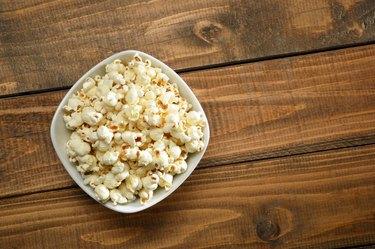Bowl of Popcorn on Wood Background