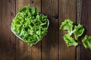 Organic lettuce bowl shot from above on rustic wood table