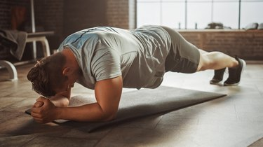 Man holding plank with proper form.