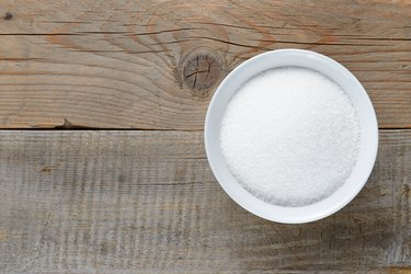 White sugar on wooden table