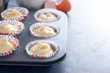 Raw cupcake dough in a cupcake baking dish for yogurt substitute