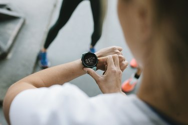 A woman checking her fitness tracker during a workout