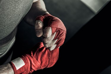 Closeup hand of boxer with red bandages