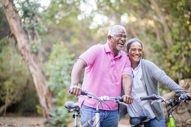 Senior African-American couple riding bikes together to help prevent type 2 diabetes
