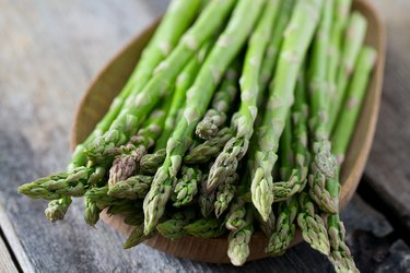 asparagus on wooden surface