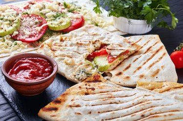 grilled flatbread stuffed with veggies and cheese