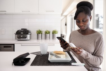 African woman taking blood sugar level in different time of the day