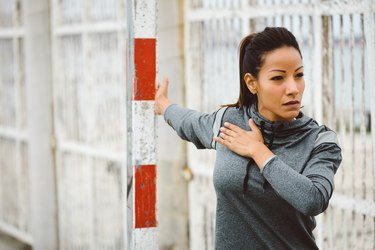 Fitness woman chest stretching