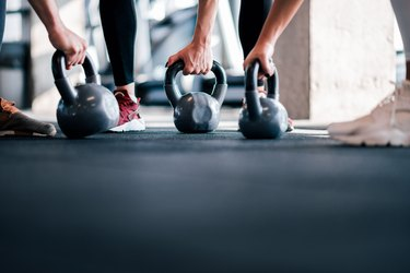 Cross training with kettle bells, low angle image, copy space.
