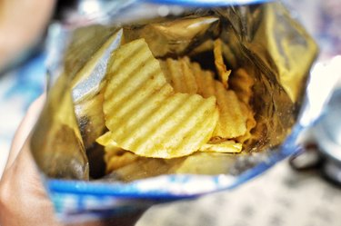 Top view of an open bag of potato chips