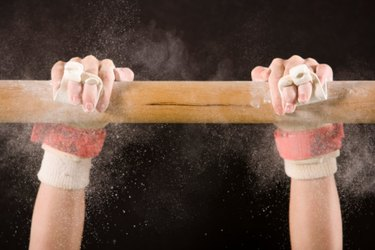 close up of gymnast's hands on bar