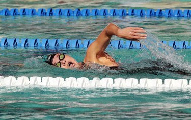 person swimming 100 meters