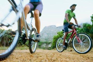 Low angle view of two people mountain biking