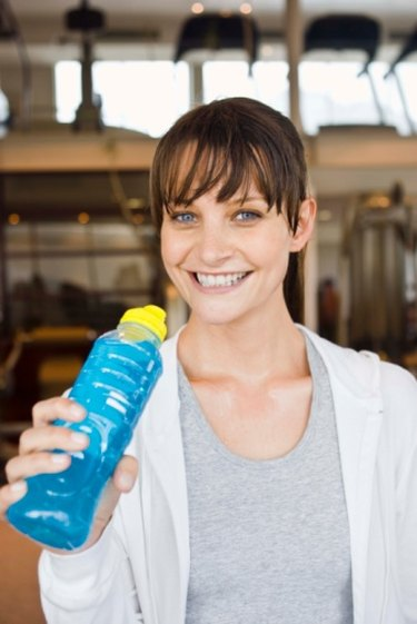 person drinking blue sports drink who lost 80 pounds