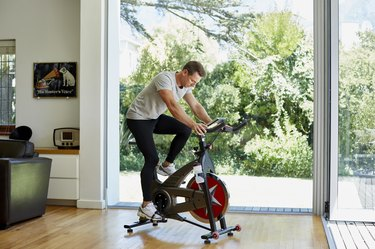 Man working out on exercise bike at home
