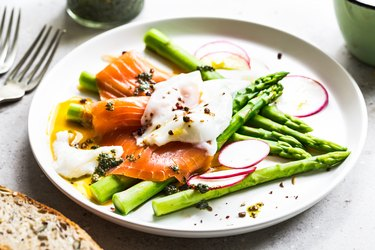 Smoked salmon with poached egg and asparagus delivering protein to prevent hair loss