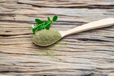 Stevia powder in wooden spoon