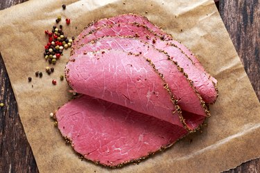 Peppered corned beef slices on paper