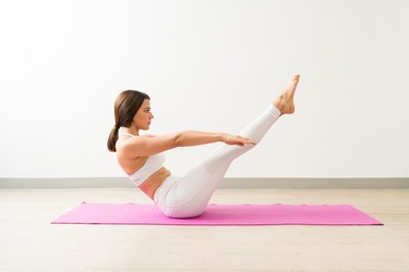 Woman doing yoga boat pose