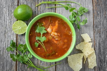 Tortilla Soup with Cheese, Lime, Cilantro and Wooden Spoon