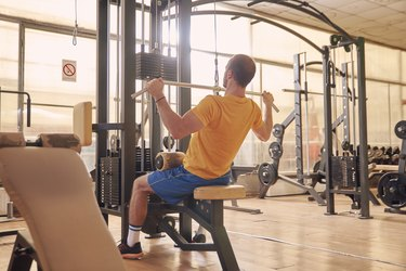 Man doing lat pulldown for better posture