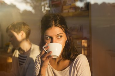 Woman drinking coffee to get health benefits of coffee