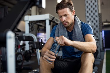 Man with water bottle at gym