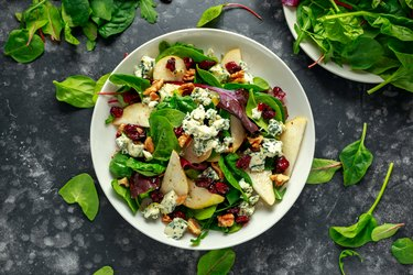 Fresh Pears, Blue Cheese salad with vegetable green mix, walnuts, cranberry. healthy food