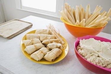 Tamales, corn husks, and masa