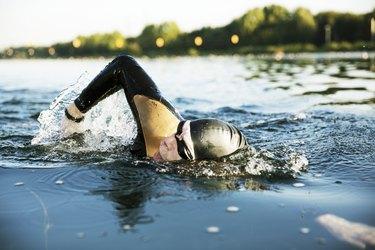 over-50 triathlete swimming in lake