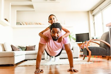 Father and son, home exercising
