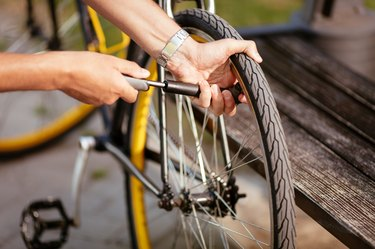 Man Inflating a Bike Tire