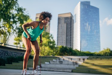 Beautiful young woman exercising in park.