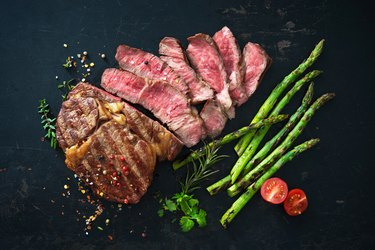 Roasted rib eye steak with green asparagus