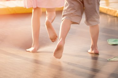 children's legs running on the trampoline