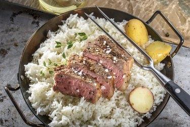 Sliced Grilled Steak with Sea Salt over Steamed Rice