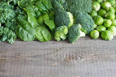 Green vegetables and herbs background concept