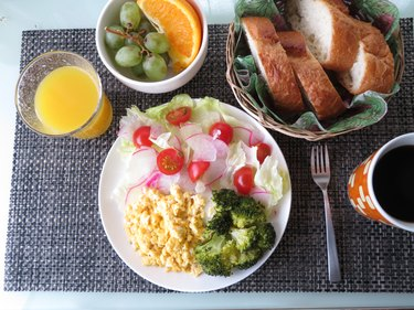 Scrambled egg breakfast with salad, fruit, coffee