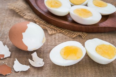 Boiled eggs and wooden plate