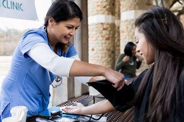 Nurse checks patient's blood pressure