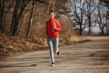 Young female runner jogging outdoors