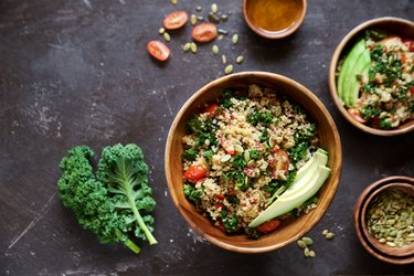Quinoa salad with kale, cherry tomatoes and pumpkin seeds