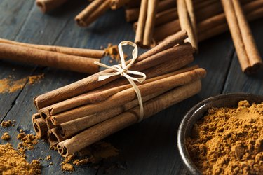 A bundle of cinnamon sticks and ground cinnamon as a spice for weight loss