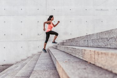 latina sports woman running up outdoor stairway in berlin
