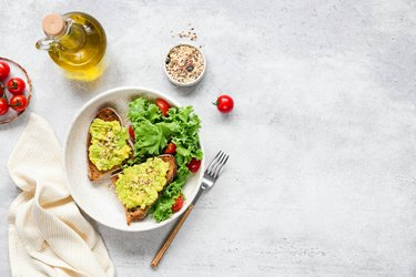 Avocado toast served with fresh green salad