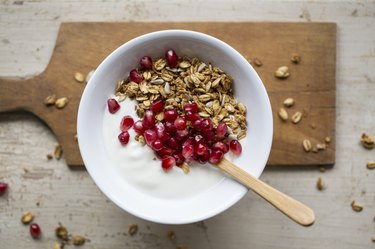 Yoghurt with granola and pomegranate seeds